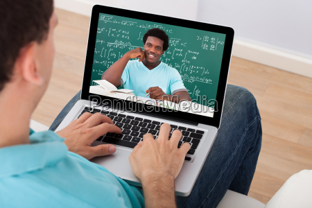 man attending online maths lecture at