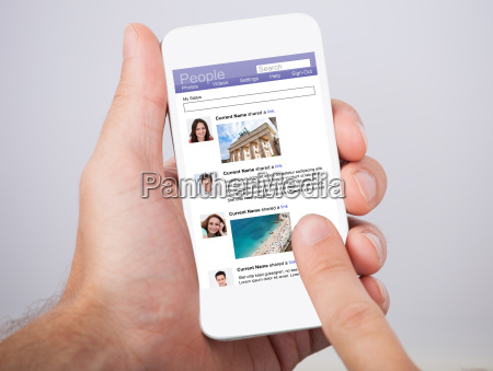 hand holding smartphone with social site