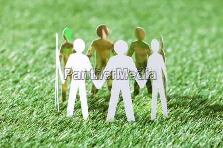 team of paper people on grassy