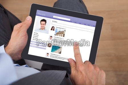 businessman surfing social networking site on