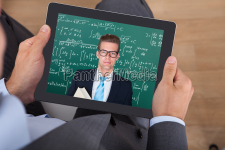 businessman, attending, online, math's, lecture, on - 12540880