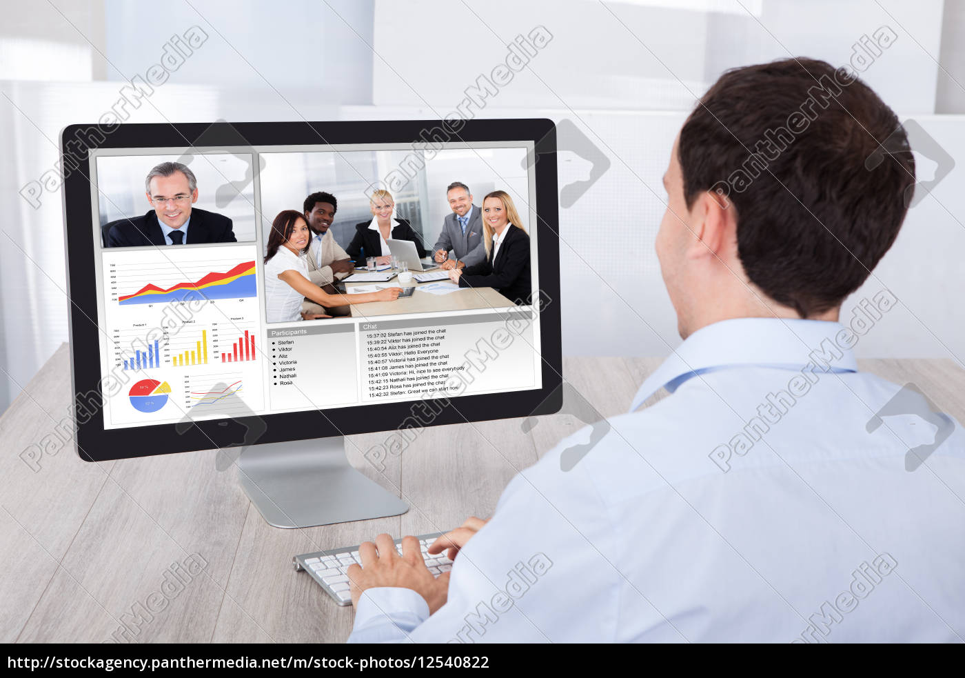 businessman, video, conferencing, with, colleagues, on - 12540822