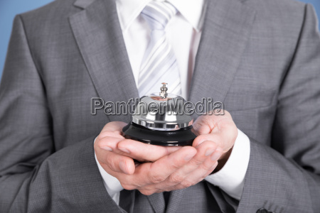 concierge holding service bell