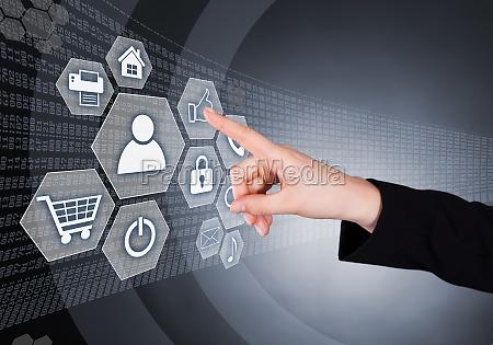 businesswoman touching transparent screen