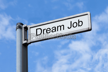 signpost with dream job sign against