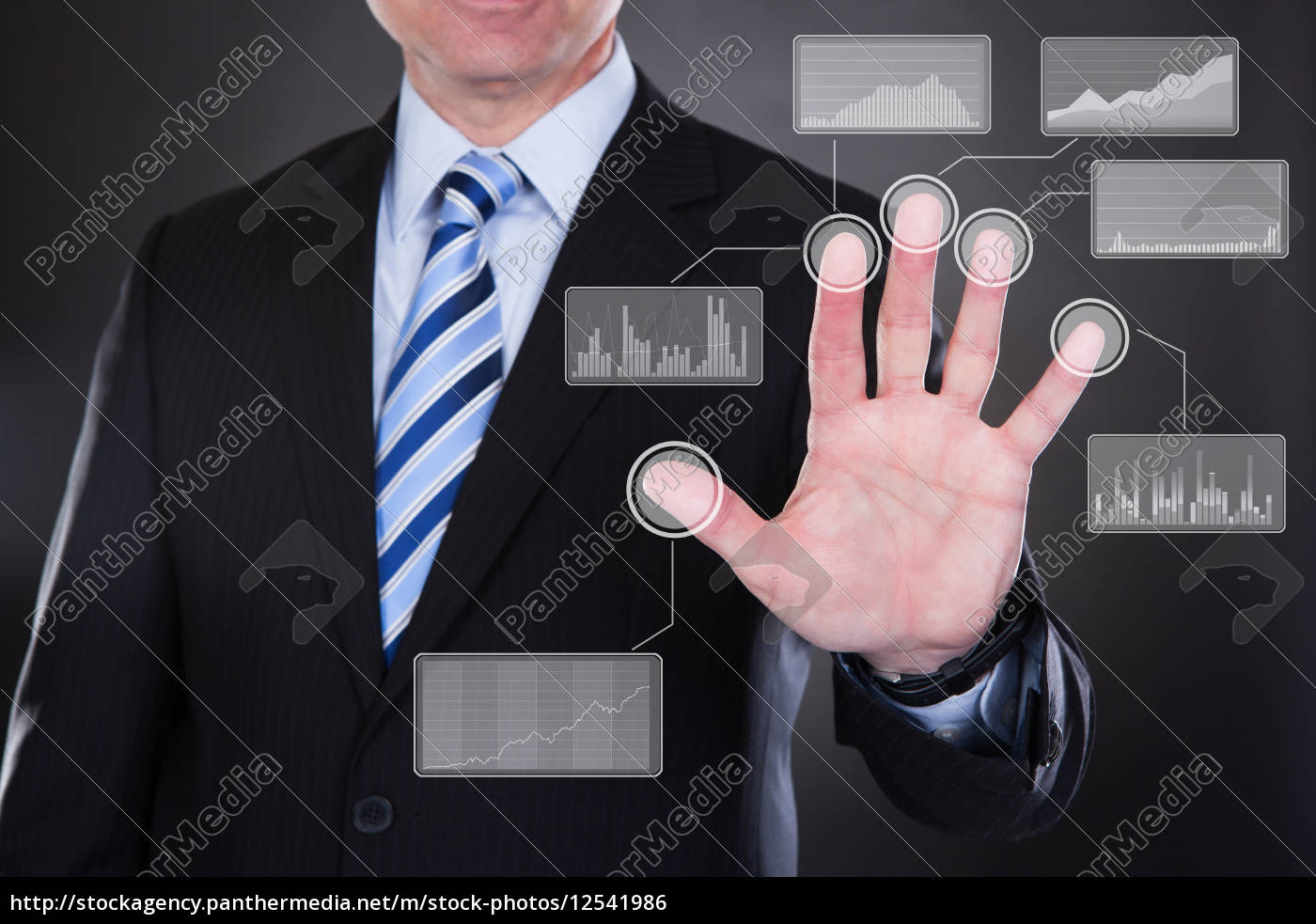 businessman, touching, the, screen - 12541986