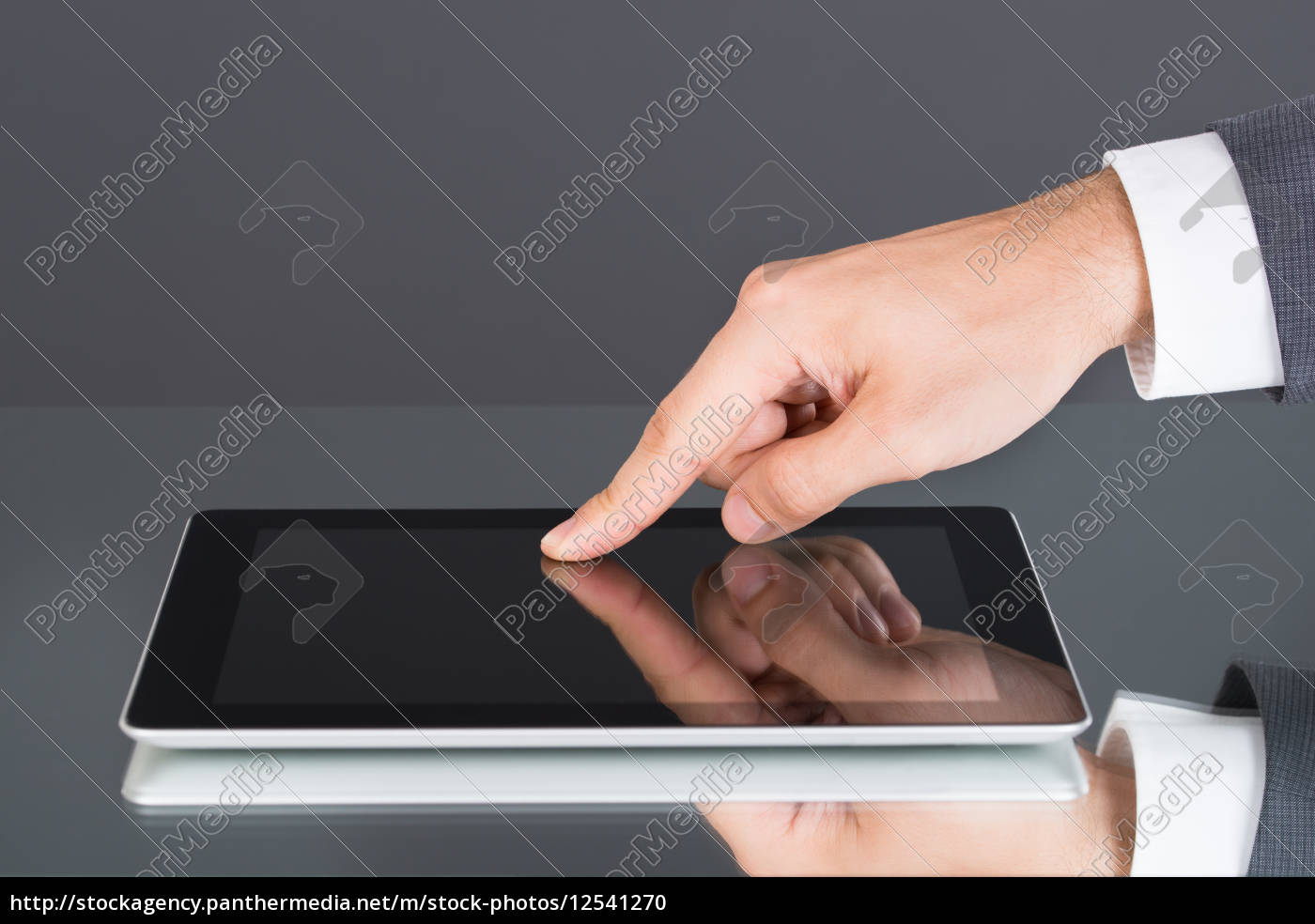 hand, pointing, at, tablet, computer, screen - 12541270