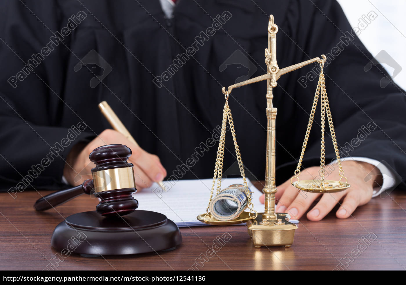 male, judge, signing, document, in, courtroom - 12541136