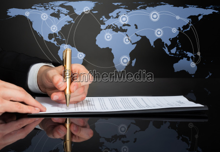 cropped image of businessman signing contract