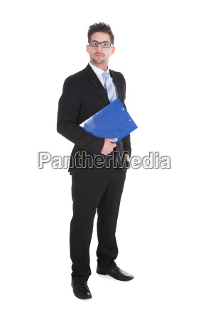 confident young businessman holding clipboard