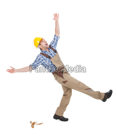 manual worker falling over white background