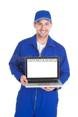 mechanic displaying laptop over white background