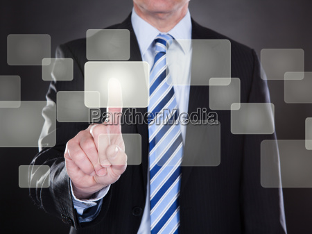 businessman touching the screen