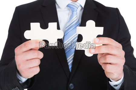 businessman, holding, jigsaw, puzzle - 12542382