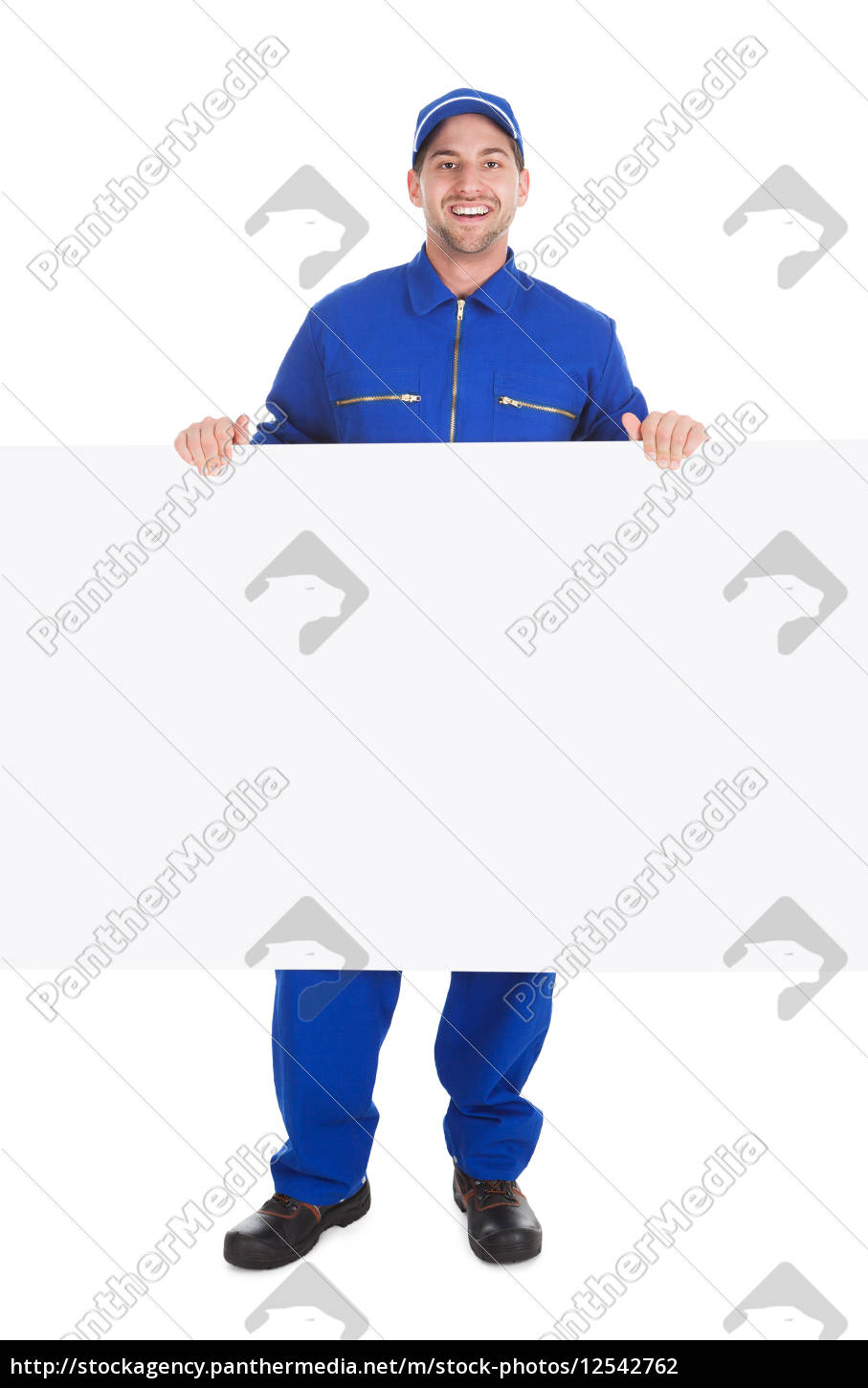 smiling, manual, worker, with, billboard - 12542762