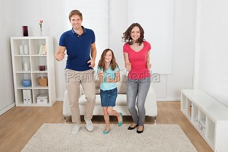 happy family pretending to run