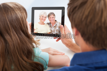 daughter with father video chatting on