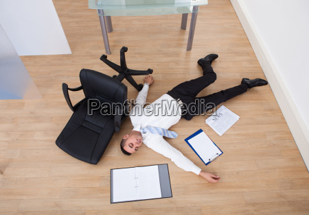 businessman, fallen, from, office, chair - 12543240