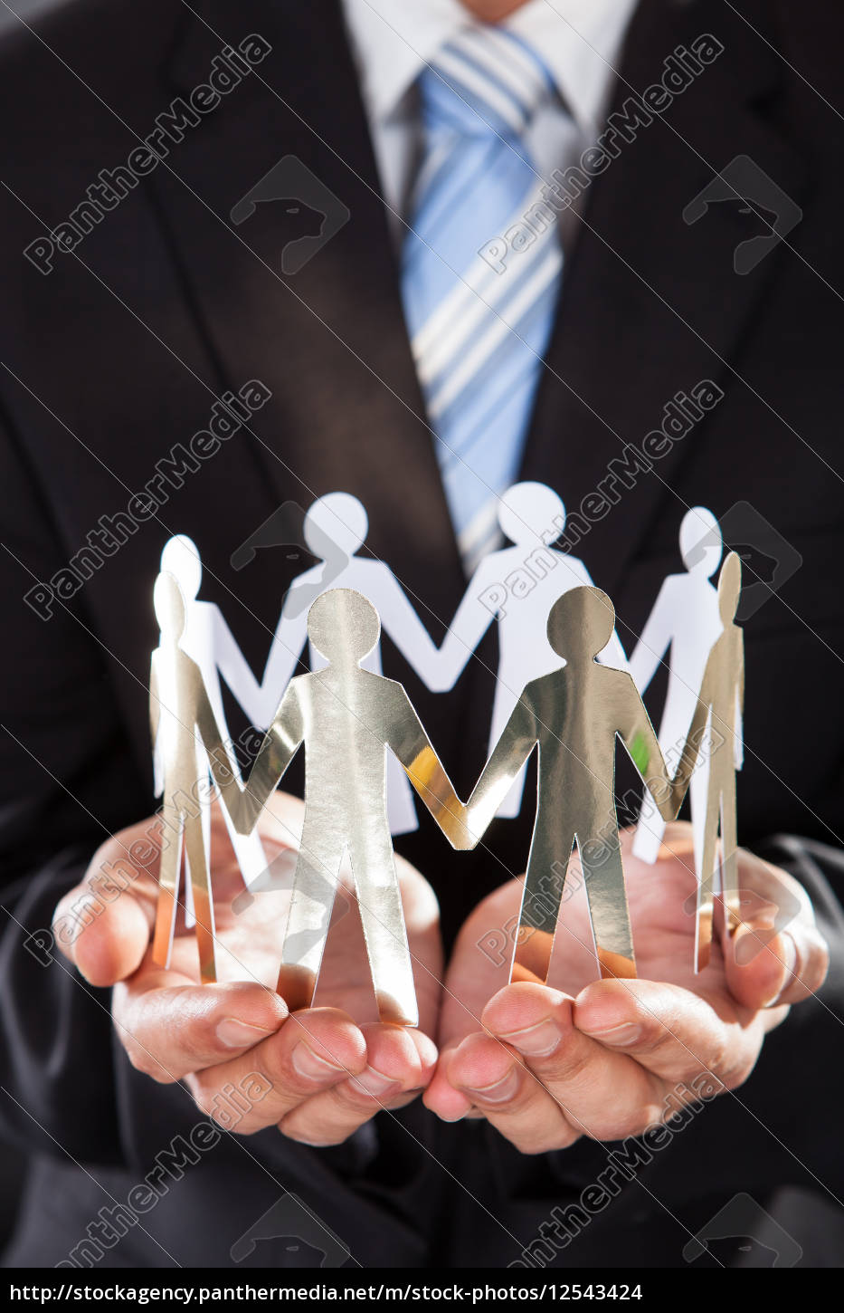 businessman, holding, metal, team, in, cupped - 12543424