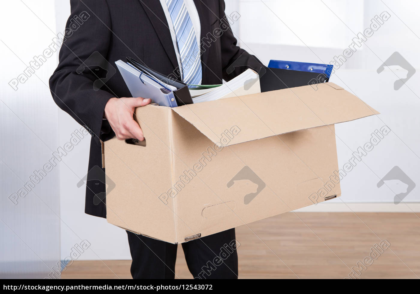 businessman, moving, out, with, cardboard, box - 12543072