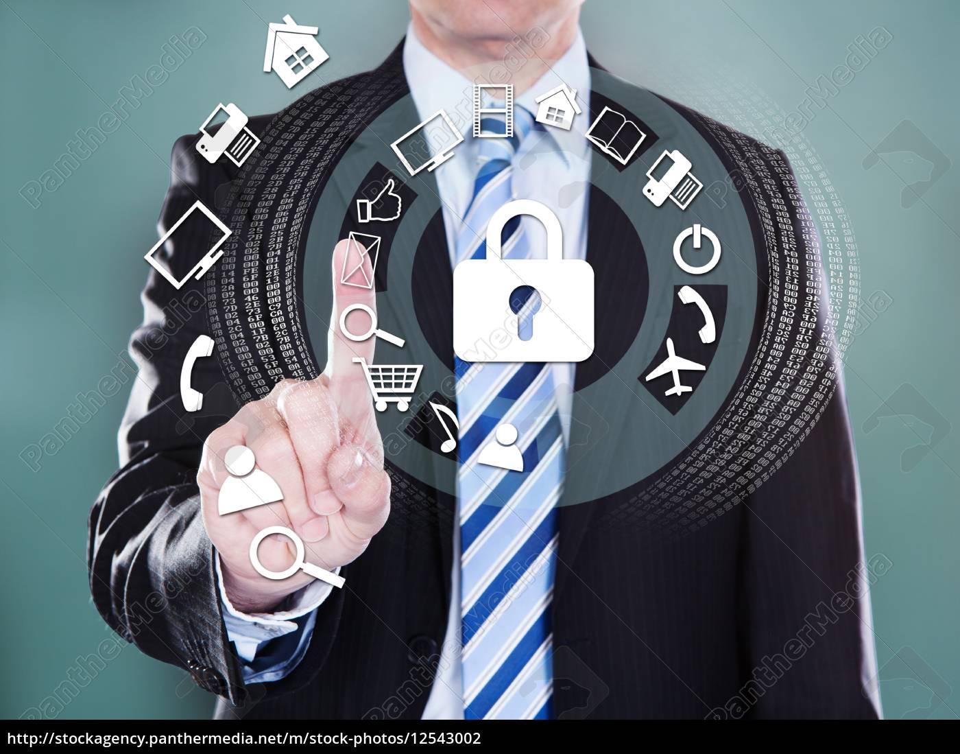businessman, touching, the, screen - 12543002