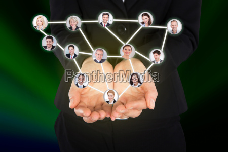 businesswoman, holding, connected, team, representing - 12543028