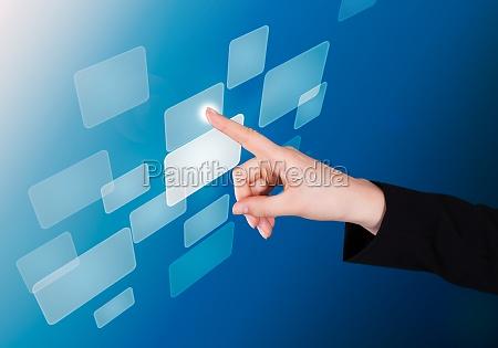 businesswoman, pushing, button, on, transparent, screen - 12543010