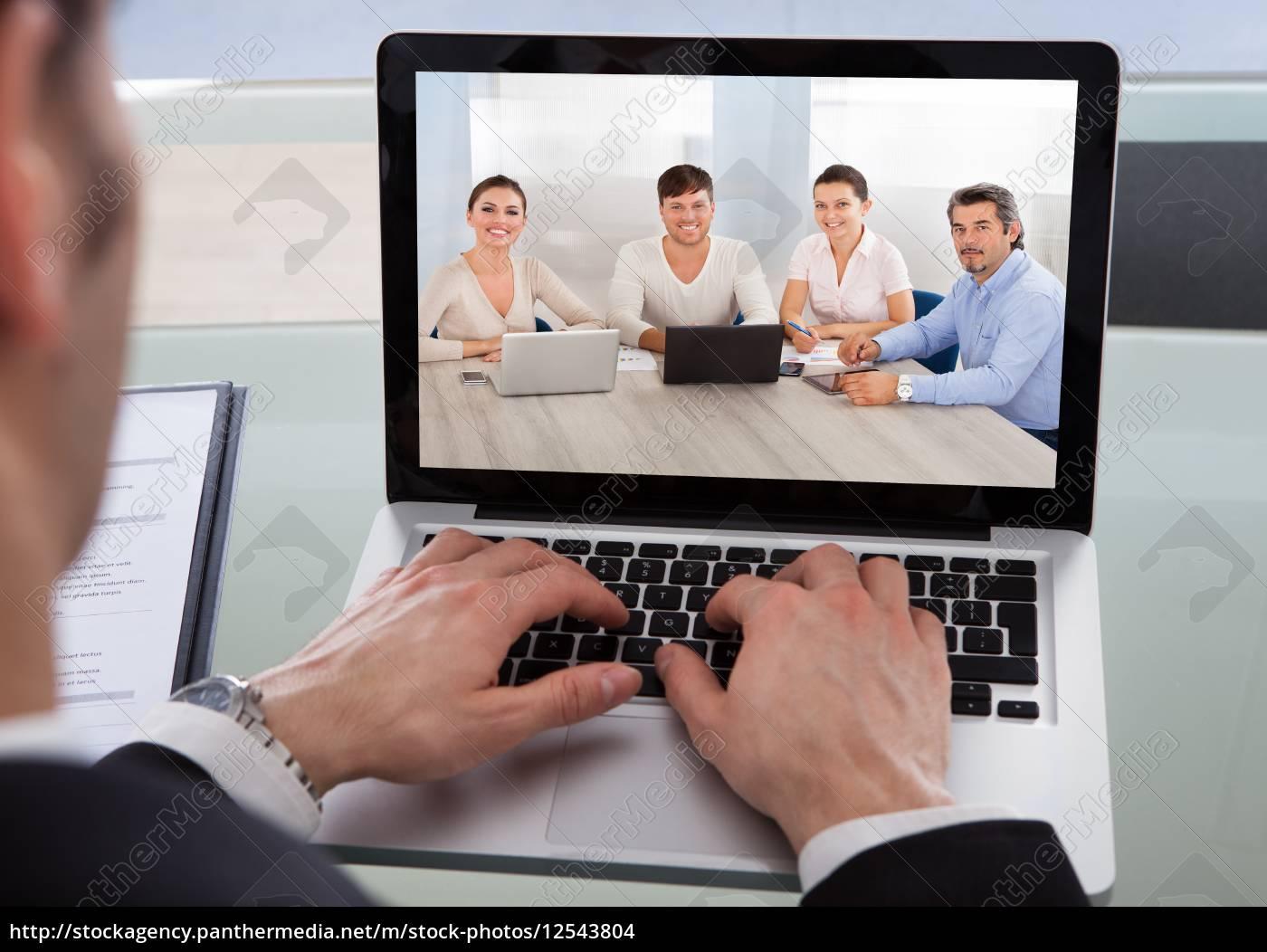 cropped, image, of, businessman, using, laptop - 12543804