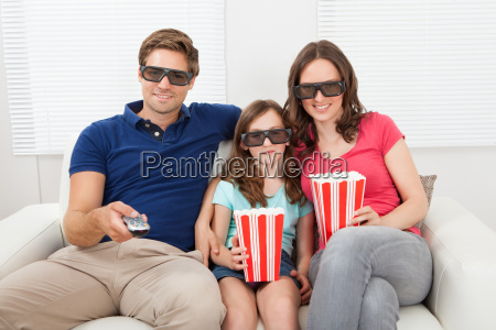 smiling, family, watching, 3d, movie, at - 12543490