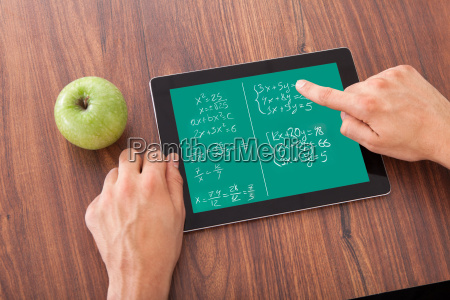 student, solving, math's, problem, on, digital - 12543272