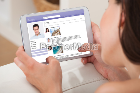 woman using digital tablet to chat