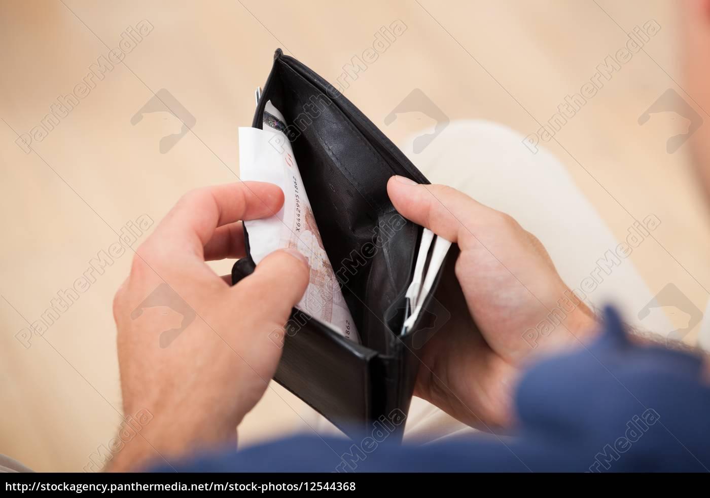 broke, man, holding, wallet - 12544368