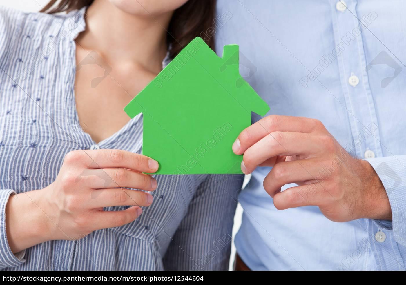 couple, holding, green, house, model - 12544604