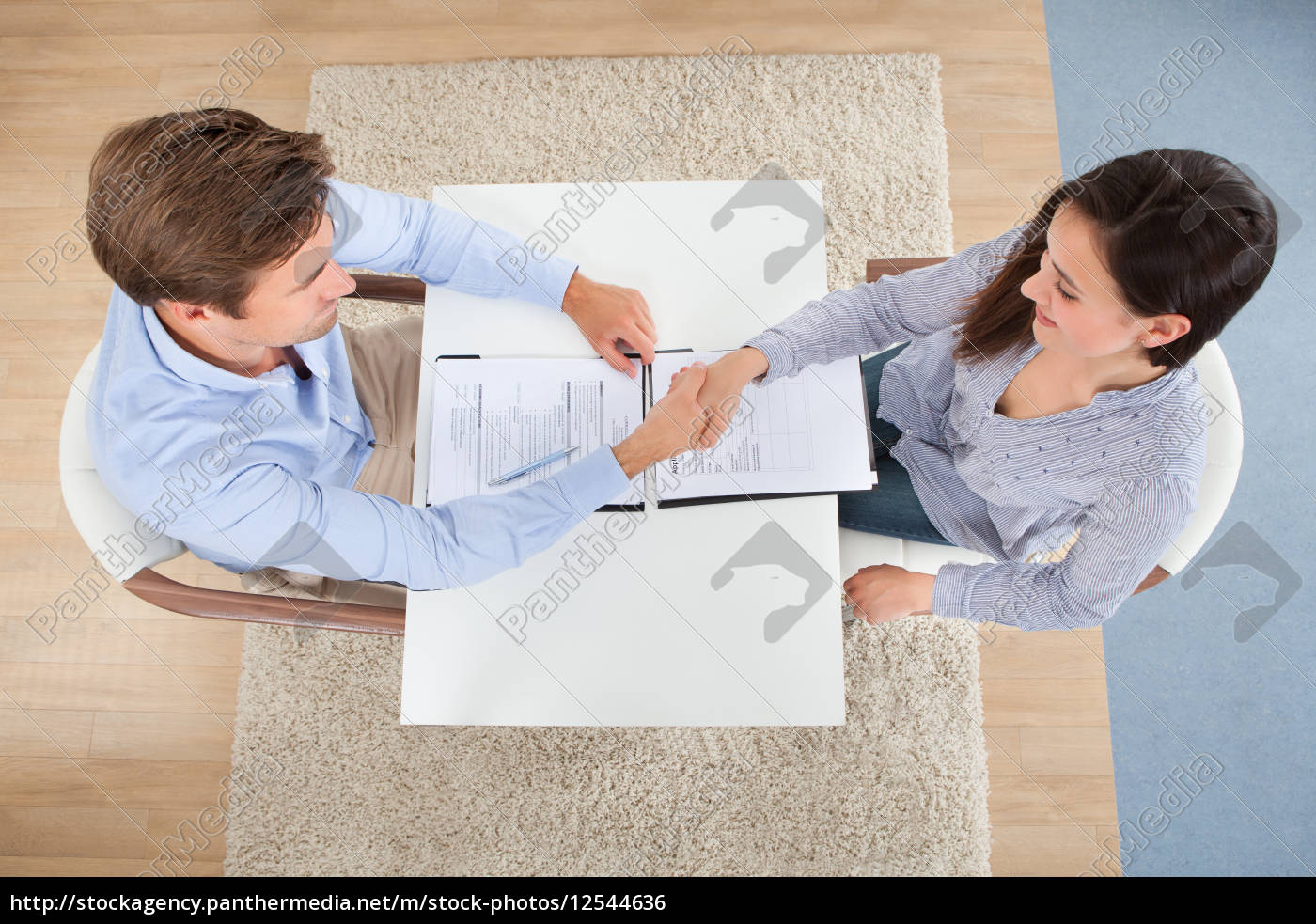 female, candidate, shaking, hand, with, businessman - 12544636