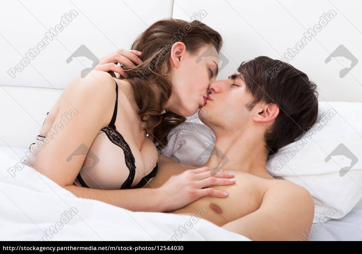 intimate, couple, kissing, in, bed - 12544030