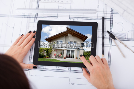 architect, with, digital, tablet, and, blueprint - 12546708