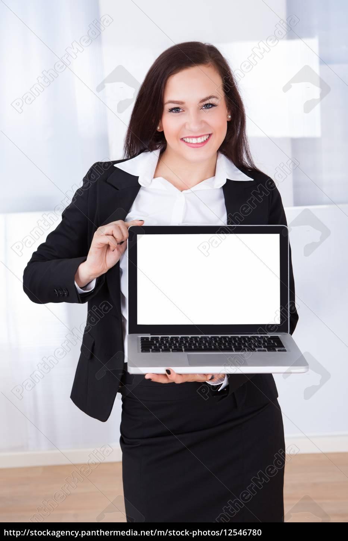 businesswoman, showing, laptop - 12546780