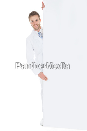 happy male doctor displaying billboard