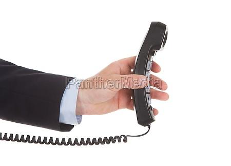 businessman, holding, telephone, receiver - 12547128