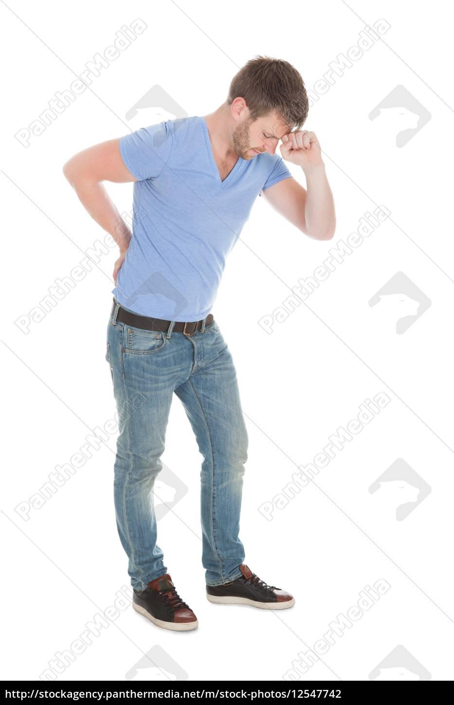 mid, adult, man, suffering, from, backache - 12547742