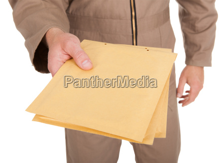 midsection, of, postman, holding, envelopes - 12547464