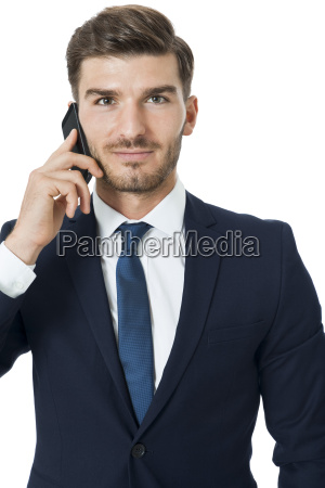 young businessman chatting on his mobile