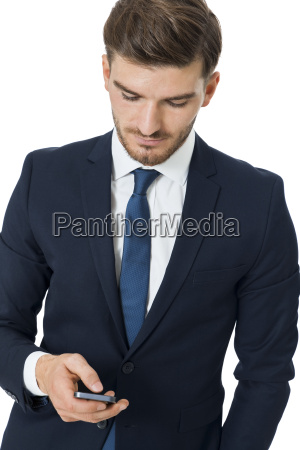 young businessman chatting on his cell