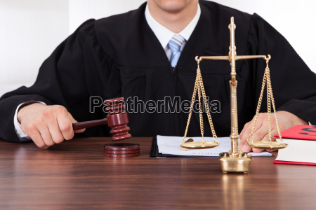 judge with mallet and weight scale