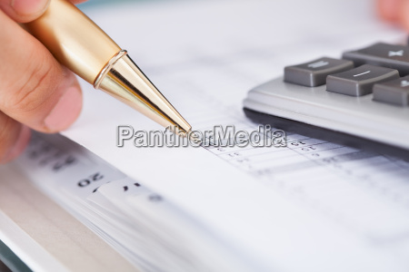businessman checking expense in office