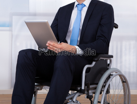 businessman, using, digital, tablet, on, wheelchair - 12551286