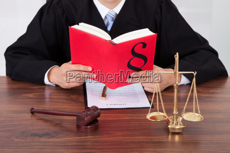 judge, reading, book, at, table, in - 12551654