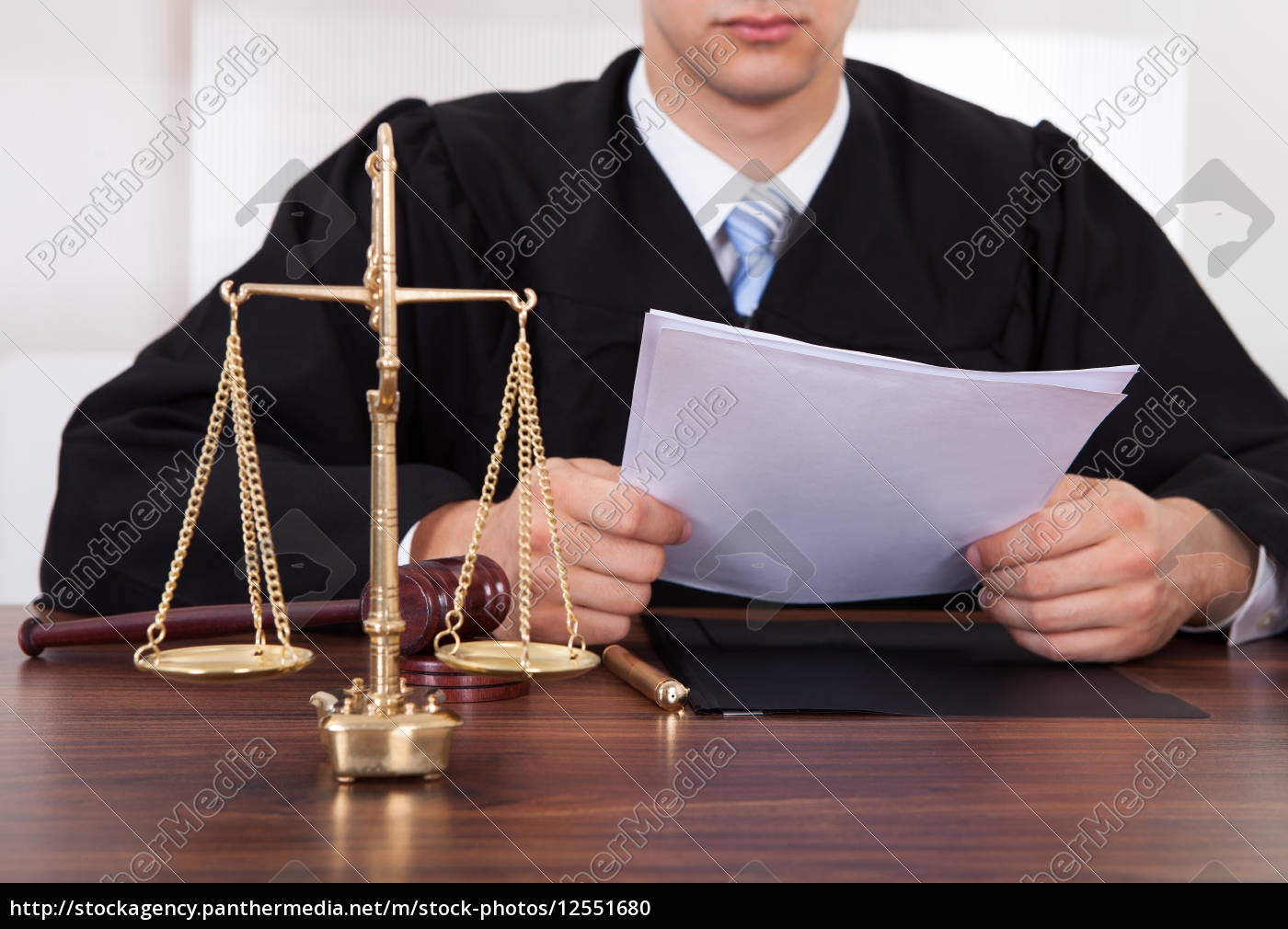 judge, reading, document, at, table, in - 12551680