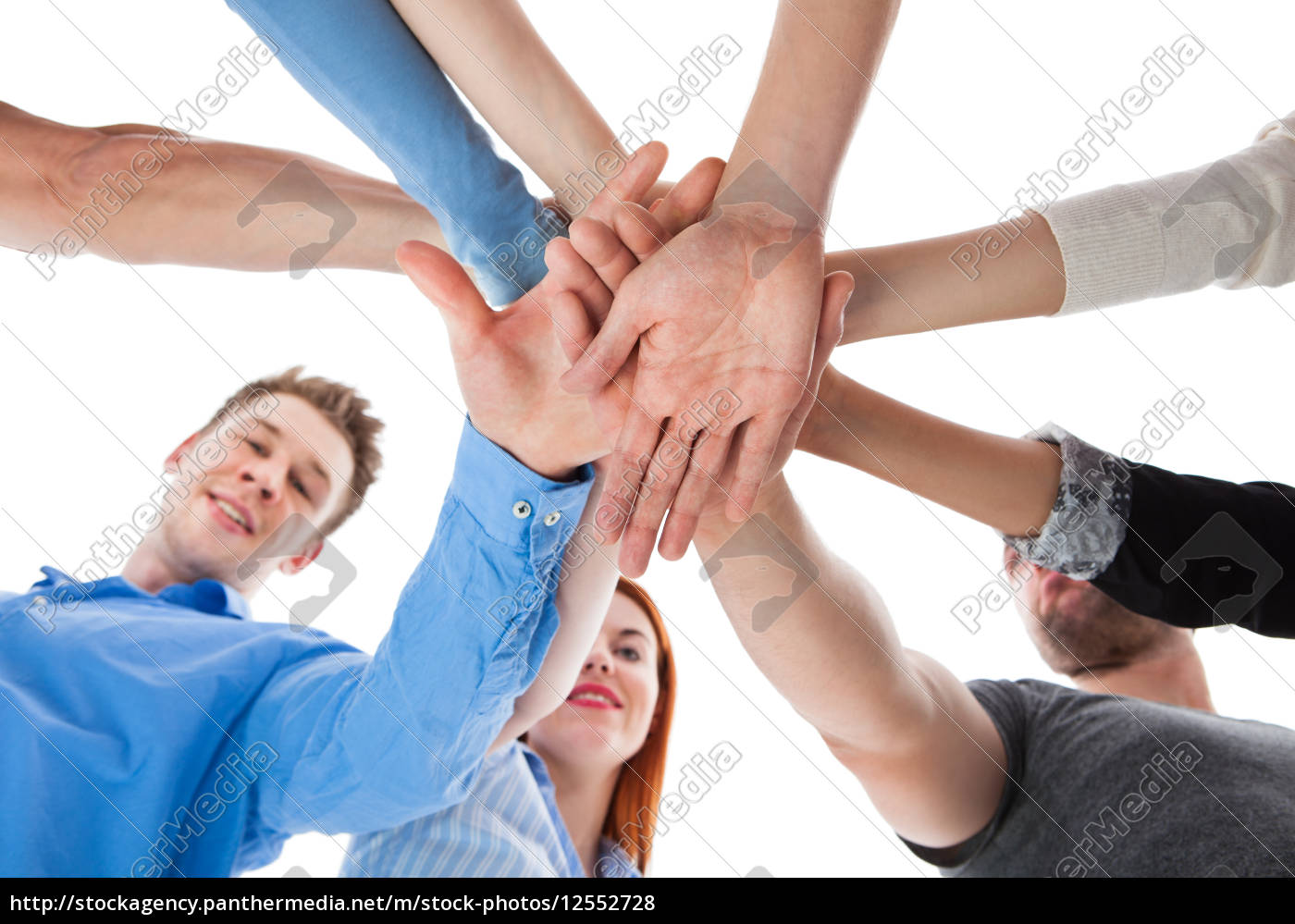 group, of, people, stacking, hands, together - 12552728