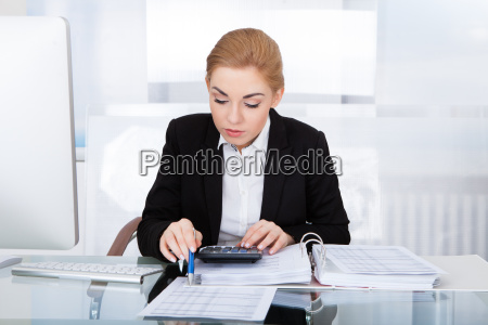 businesswoman calculating bills